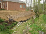Redi-Rock retaining wall substantially complete
