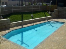 Swimming Pool and concrete paver and retaining wall