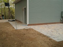 Rear patio connected to garage area with walk way