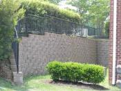 Retaining wall at corner of apartment building