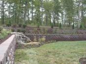 side view of water feature on retaining wall