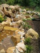 Waterfall near retaining wall